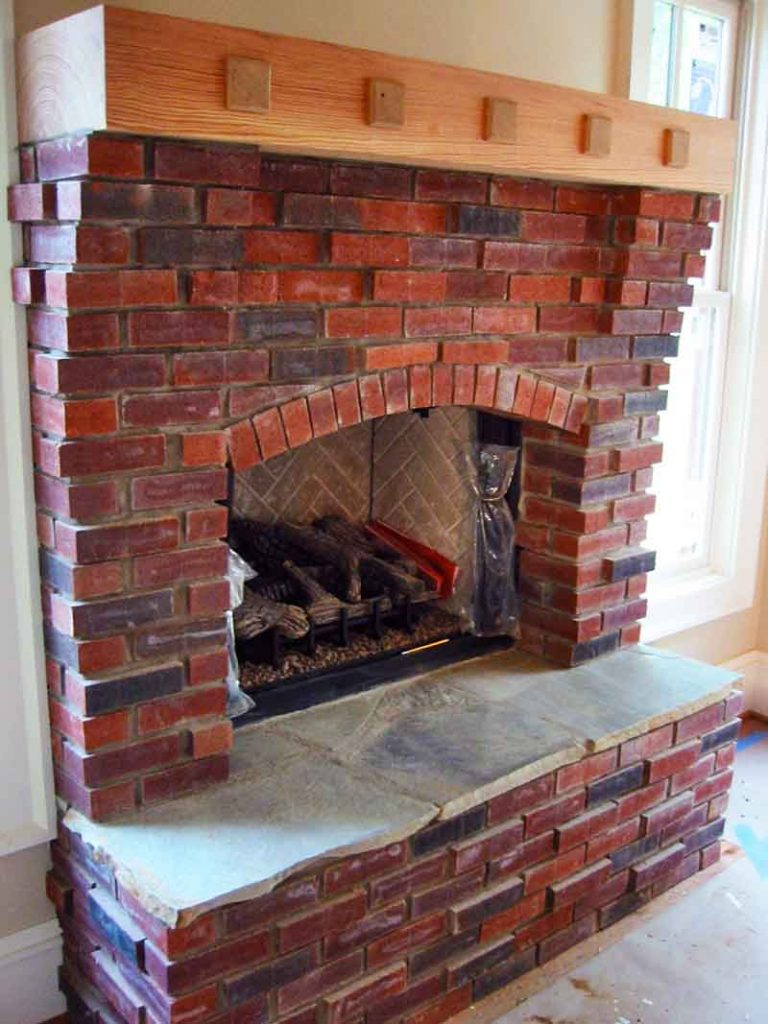 Image of: Inside Red Brick Fireplace Wooden Mantle Huntsville Brick Stone